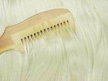 Hair brush brushing blond hair Royalty Free Stock Photography