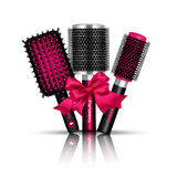 Hair Brush Composition. Realistic hair brush composition with three hairbrushes for styling tied a red ribbon vector illustration Royalty Free Stock Image