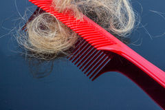 Hair brush with hair Stock Photo