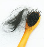 Hair brush with lost hair Stock Images