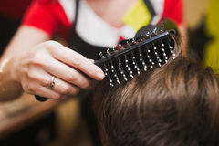 Hair and brush. Hair stylist brush close up Royalty Free Stock Photos