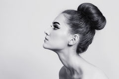 Hair bun. Black and white shot of young beautiful girl with hair bun Royalty Free Stock Images