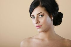 Hair in a bun. Model has hair put in bun by stylist and makeup applied by professional Stock Photo