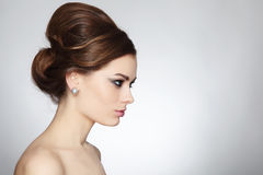 Hair bun. Profile portrait of young beautiful woman with stylish hair bun stock image