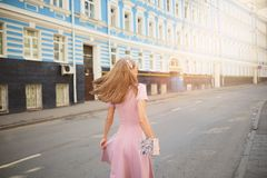 Fashionably dressed woman on the streets of a small town, shopping concept royalty free stock photos