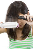 Hair care. Young teenager smooths the hair Stock Image