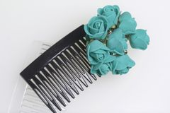Hair care. Accessories and decorations. Two scallops for hair are transparent and black in color. Artificial rose flowers are emer Stock Image