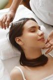 Hair Care. Beautiful Woman Receiving Brushing Beauty Treatment. Hair Care. Closeup Of Beautiful Woman Receiving Medical Hair Beauty Treatment At Cosmetology Royalty Free Stock Photography