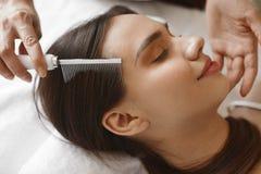 Hair Care. Beautiful Woman Receiving Brushing Beauty Treatment. Hair Care. Closeup Of Beautiful Woman Receiving Medical Hair Beauty Treatment At Cosmetology Stock Image