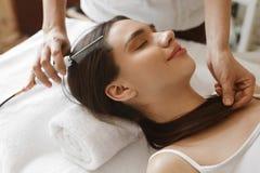 Hair Care. Beautiful Woman Receiving Brushing Beauty Treatment. Hair Care. Closeup Of Beautiful Woman Receiving Medical Hair Beauty Treatment At Cosmetology Royalty Free Stock Photo