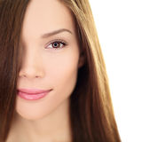 Hair care beauty woman with long hair - brunette. Hair care beauty woman with long hair. Female brunette beauty and hair treatment close up. Mixed race Asian Royalty Free Stock Images