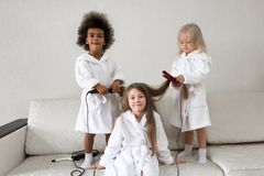 Hair care in children. Baby hairstyles stock photos