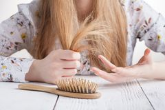 Hair Care. Closeup Of Beautiful Woman Hairbrushing Hair With Bru. Sh. Portrait Of Sexy Female Woman Brushing Long Straight Healthy Hair With Hairbrush. Health Royalty Free Stock Photography
