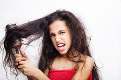 Hair care concept with portrait of girl brushing her hair Stock Photo