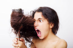 Hair care concept with portrait of girl brushing her hair Royalty Free Stock Image