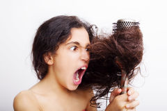 Hair care concept with portrait of girl brushing her hair Royalty Free Stock Photo