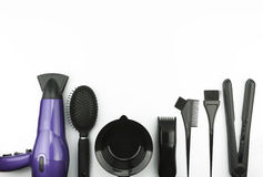 Hair care set on white background. Hairdressing tools background. Overhead of essentials of a modern woman. Hair care objects frame Stock Photos