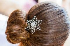 Hair clip. The diamond hair clip in the hair of a woman Royalty Free Stock Photo