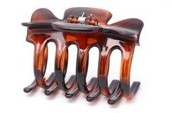 Hair Clip. Brown hair clip isolated bright Royalty Free Stock Photos