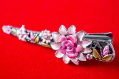 Hair clip with jewelry and flower. Close up stock photo