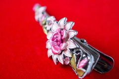 Hair clip with jewelry and flower. Close up stock image