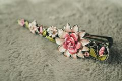 Hair clip with jewelry and flower. Close up royalty free stock photos