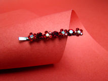 Hair clip and red paper Royalty Free Stock Photo