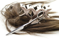 Hair clip and scissors with hair Royalty Free Stock Photos