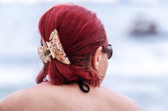 Hair clip woman head beach red Royalty Free Stock Image