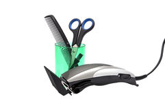 Hair clipper, comb and scissors stock photo