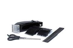 Hair clipper, comb and scissors white background. Hair clipper, comb and scissors on white background stock photos