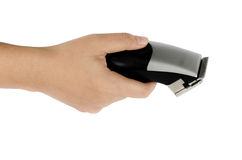 Hair clipper in hand. On white background royalty free stock photography