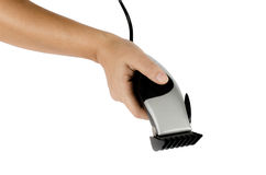 Hair clipper in hand. On white background stock image