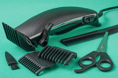 Hair clipper isolated on white background. Black hair clipper placed on green background stock photography