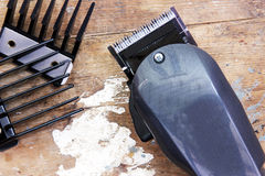 Hair clipper. On rusty wooden background royalty free stock photos