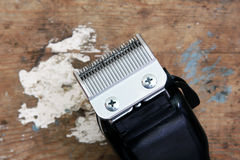 Hair clipper. On rusty wooden background stock photo