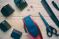 Hair clipper set on wood background royalty free stock image