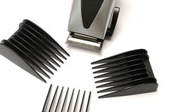 Hair clipper tool. Hair clipper with different size attachment royalty free stock image