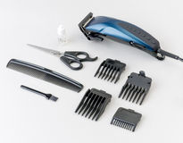 Hair clipper tools isolated. Hair clipper salon tools with accessory isolated stock photography