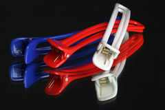 Hair clips. Red white and blue hair clips Royalty Free Stock Image