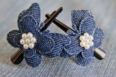 Hair clips. Blue hair clips on jeans background stock photos