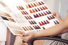 Hair Color Swatches. Young woman holding hair color swatches Royalty Free Stock Photos