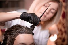 Free Hair Coloring In The Salon, Hair Styling. Professional Wizard Paints The Hair In The Salon. Beauty Concept, Hair Care. Stock Photo - 150936080