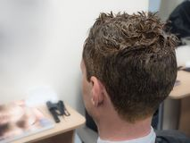 Hair coloring on a man in a beauty salon. stock photography