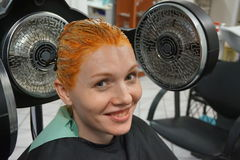 Hair coloring Stock Images