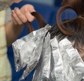 Hair coloring in the salon.  Royalty Free Stock Images