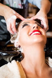 Hair coloring in the salon Stock Images