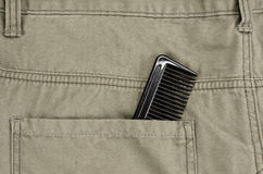 Hair comb in pocket Royalty Free Stock Images