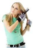 Hair combing teenager girl Stock Photo