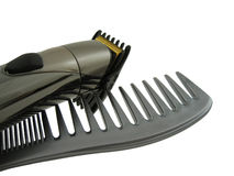 Hair comp and electric clipper. Isolated Stock Image